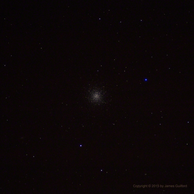 The Hercules Globular Cluster - M13 Through a Small Telescope. Photo by James Guilford.