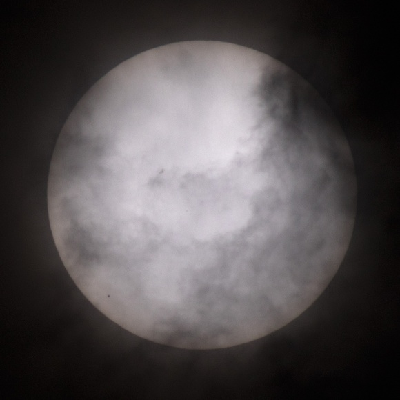 Photo: Transit of Mercury blocked by clouds. Photo by James Guilford.