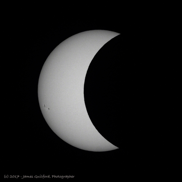 Photo: Sun in process of being eclipsed by Moon. August 21, 2017. Photo by James Guilford.