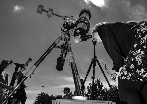 Photo: Solar Telescopes Trained on the Eclipse - Credit: Dave Dreimiller