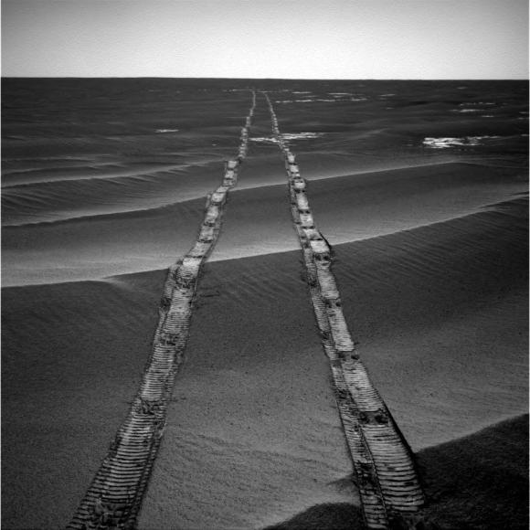 In this navigation camera raw image, NASA's Opportunity Rover looks back over its own tracks on Aug. 4, 2010. Image Credit: NASA/JPL-Caltech