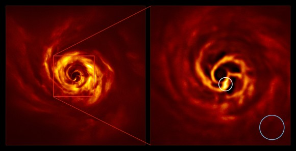 The images of the AB Aurigae system showing the disc around it. The image on the right is a zoomed-in version of the area indicated by a red square on the image on the left. It shows the inner region of the disc, including the very-bright-yellow 'twist' (circled in white) that scientists believe marks the spot where a planet is forming. This twist lies at about the same distance from the AB Aurigae star as Neptune from the Sun. The blue circle represents the size of the orbit of Neptune. The images were obtained with the SPHERE instrument on ESO's Very Large Telescope in polarized light. Credit: ESO/Boccaletti et al.